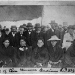 "Shinnecock Indians, 1884, Long Island Rail Road, Front row-L-R: Frances Bunn, Anna Bunn Kellis, Mary Brewer, ""Grandma O"" or unidentified, Harriet Walker Hudson. Back row L-R: Possibly Luther Bunn, Joshua Kellis, James Bunn, Unidentified, Possibly Wickham Cuffee, Unidentified."